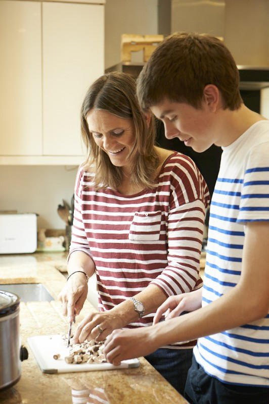 Foster carer and teenager cooking
